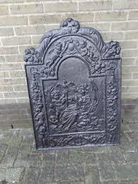large cast iron fireplace fireback with