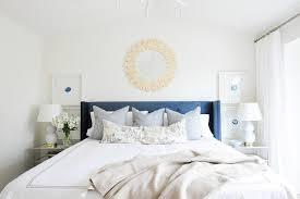 blue wingback bed with bone sunburst