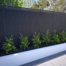 A Slimline Hardwood Screening Profile Has Been Used To Cover Up This Fence In Brighton The Simpl Backyard Fences Outdoor Gardens Design Backyard Garden Design
