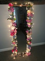bedroom mirror with faux flowers