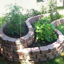 curved raised bed garden with bricks