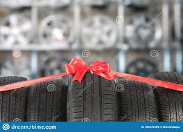 Car Tires Tied With Red Ribbon In Store Stock Image Image Of Diagnostic Business 184276469