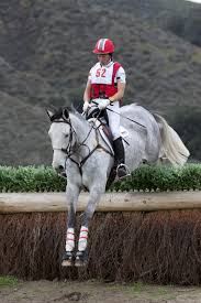 Eventer Tamra Smith tackles this cross country cross with the help ...