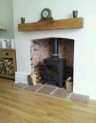 wood burner and wooden beam above