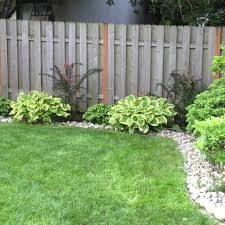 We Just Added River Rock Border Around The Yard Landscaping With Rocks Landscaping Around House Landscaping Rock