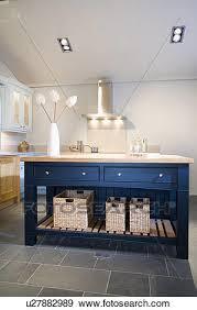 storage baskets on low shelf of blue