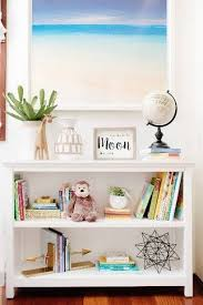 Kids Room Design White Bookshelf With Beach Print Frame Kids Room Shelves Bookshelves Kids Kid Room Decor