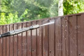 Cleaning Fence With High Pressure Power Washer Cleaning Dirty Wall Vinyl Home Products Restoration Cleaner Cleanliness Drops Grain Karcher Construction Maintenance Repair Wall Men Spring Outdoor Home Texture Plank Pressure Washing