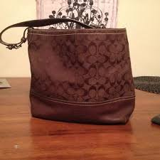 large brown coach bag with leather