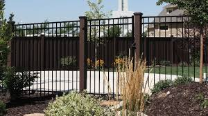 Trex Fence Posts In The Woodland Brown Color Combined With Black Powder Coated Ornamental Steel Panels The Panels Attach Trex Fencing Landscape Timbers Fence