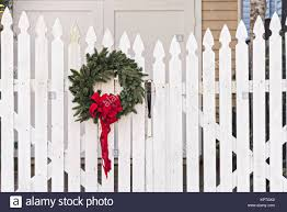 A Wooden Picket Fence Of A Historic Home Decorated With A Christmas Stock Photo Alamy