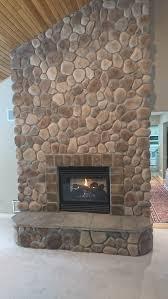 stone veneer over a brick fireplace