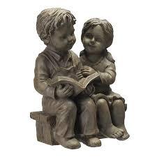 boy and girl reading garden statue