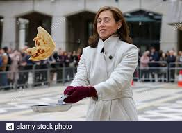 Guildhall, London, UK 25 Feb 2020 - The Lady Mayoress Hilary Russell flips  a pancake before the