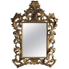 italian mirror with carved gold toned
