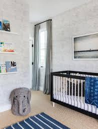 nursery crib with blue stripe rug