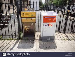 FedEx and UPS drop off boxes next to ...