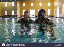 2nd Armored Brigade Combat Team, 3rd Infantry Division Sgt. 1st Class Jeffery  Johnson teaches Sgt. Oghukwu Ariwodo of 703rd Brigade Support Battalion,  2ABCT, 3ID how to tread water during hostile situations, Sept.