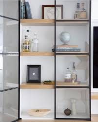 wood shelves with metal and glass doors