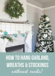 hang garland wreaths and stockings