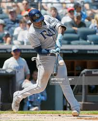 Adeiny Hechavarria of the Tampa Bay Rays hits in an MLB baseball ...