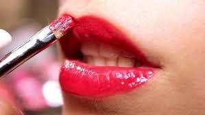 professional makeup artist paints a