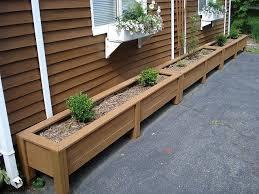 long row of diy outdoor planters