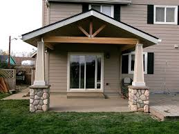 open gable patio cover with stone post