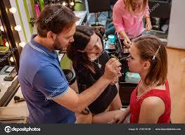 makeup teacher helping student