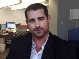Brian Sims - open necked shirt showing ...