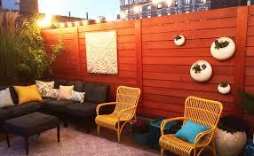 Cozy Rooftop Garden Globe Lights Horizontal Cedar Fence Wall Planters Sofa Contemporary Deck New York By Amber Freda Garden Design