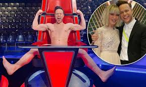 The Voice UK final: Olly Murs STRIPS ...