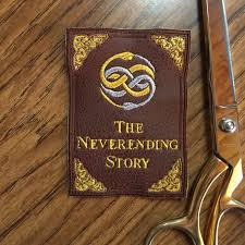 the neverending story book cover faux