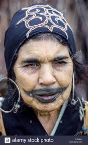 An elderly Ainu woman shows off a childhood tattoo on her face ...