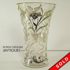 clear glass vase with silver overlay