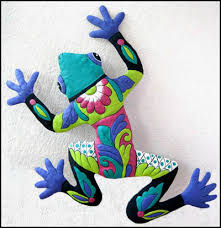 large painted metal frog wall hanging