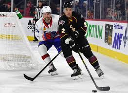 Cleveland Monsters defenseman Adam Clendening (right) vs. the ...