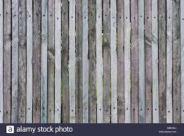 Wooden Fence From Thin Planks Fixed By Nails And Screws Many Knots Stock Photo Alamy