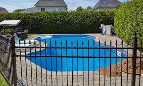 Don T Fence Me In Choosing Between Pool Fencing Options Pool Pricer Wrought Iron Pool Fence Pool Fence Pool Safety