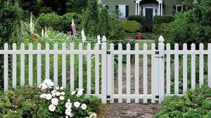 The Glendale Spaced Picket Panel With Dog Ear Tops With Gate Installed In A Beautiful Garden With A Stone Walkway Dog Ear Fence Vinyl Picket Fence Fence Styles