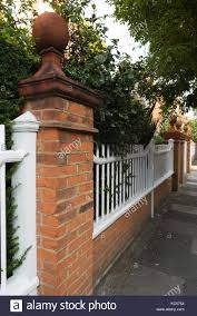 A Ball Finial On A Brick Pillar And A Wooden Palisade Fence In Queen Stock Photo Alamy