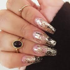 white coffin nails with gold accent