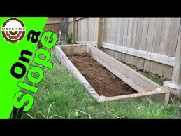 build a raised garden bed on a slope