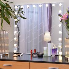 big mirror with lights white glass top