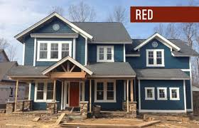 dark blue siding with gray roof house