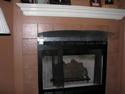 mantel above a gas fireplace