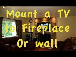 mount flatscreen tv over a fire place