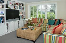 Combine Your Love For Tv And Books Decoist Small Tv Room Kid Friendly Living Room Design Small Room Interior