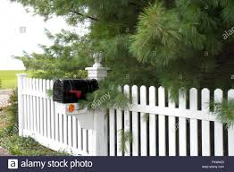 White Picket Fence With Black Mailbox In Country Setting Stock Photo Alamy