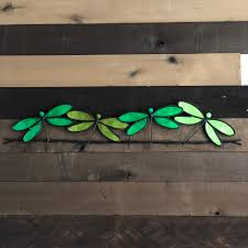 home design dragonflies on a wire wall